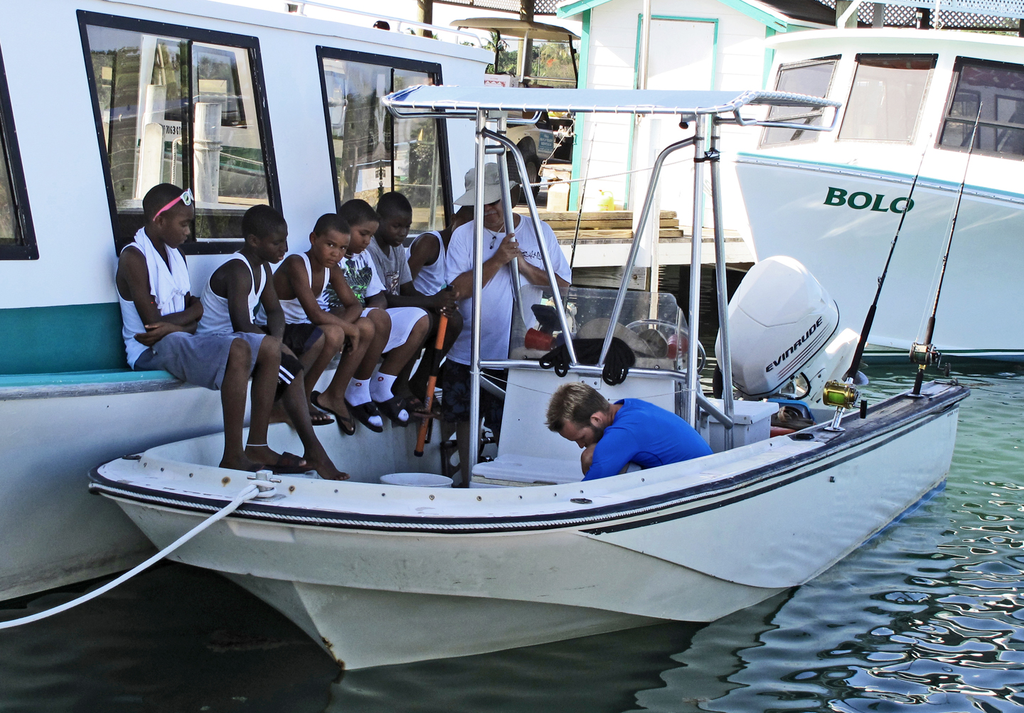 Youngsters watch a local fisherman clean the day's catch - Green Turtle Cay, Bahamas -- www.littlehousebytheferry.com