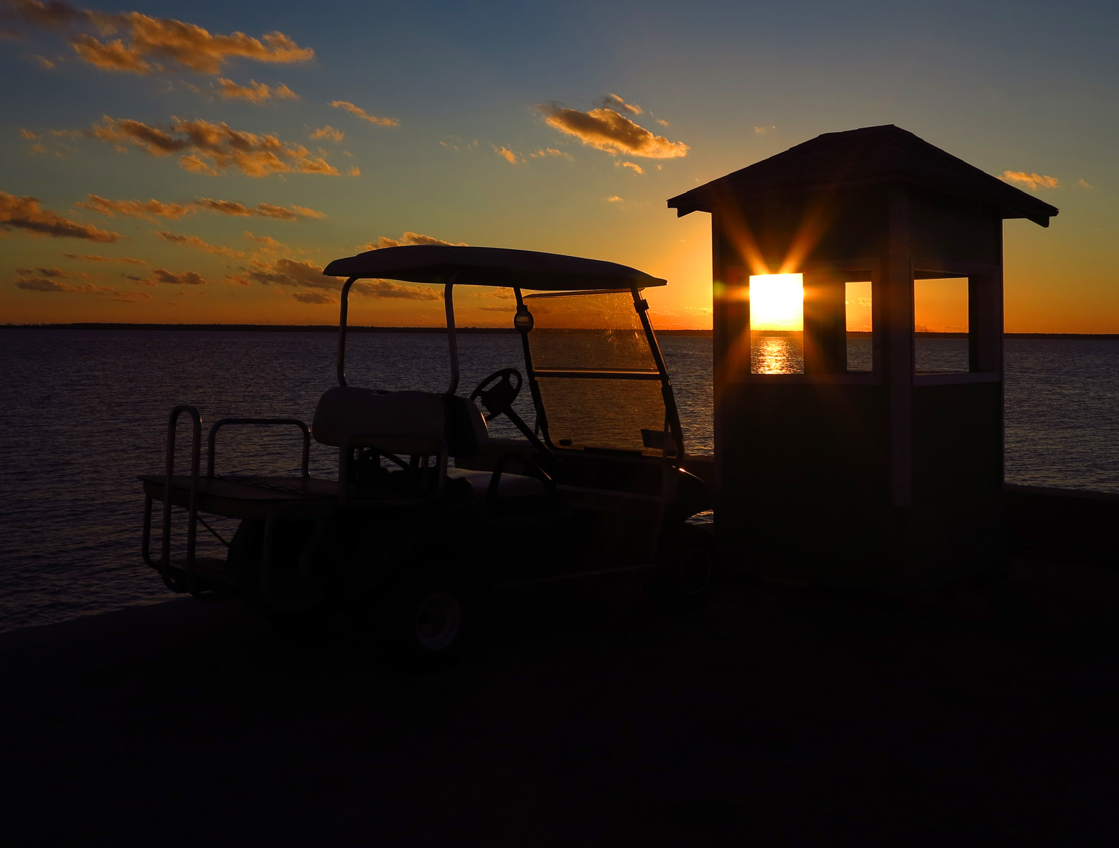 bahamas, abaco, green turtle cay, sunset, golf cart