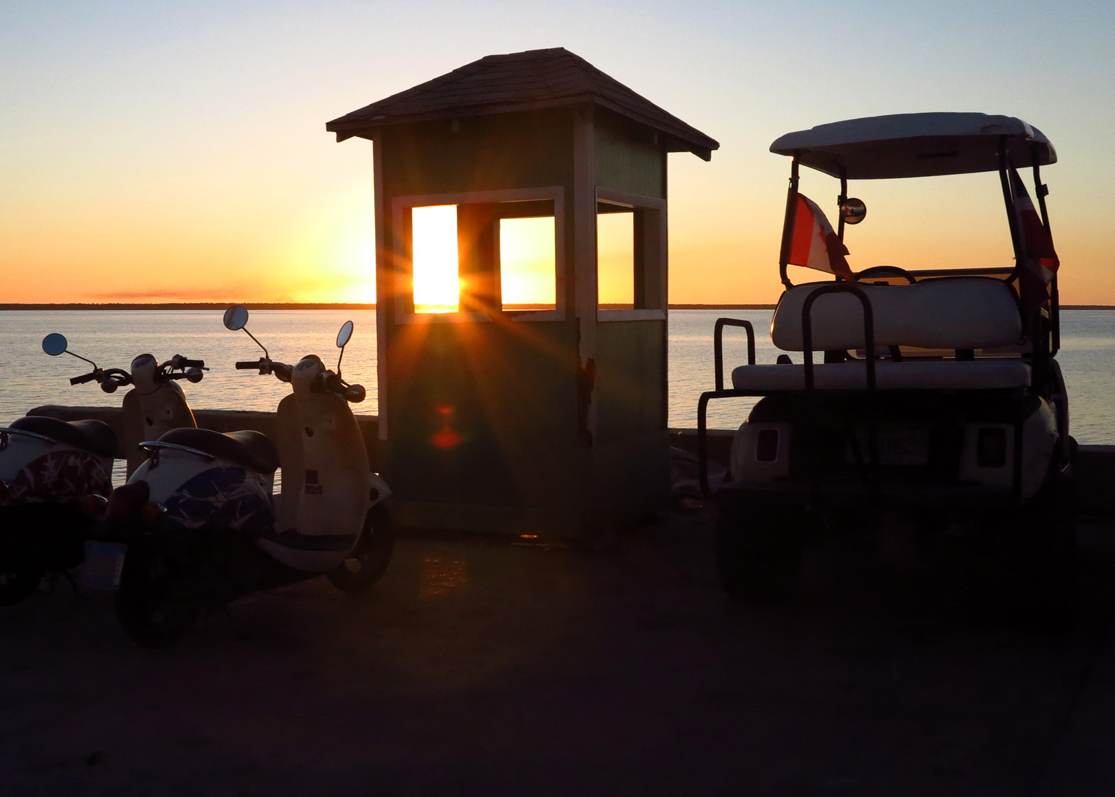 Scooters at sunset - Green Turtle Cay, Abaco, Bahamas